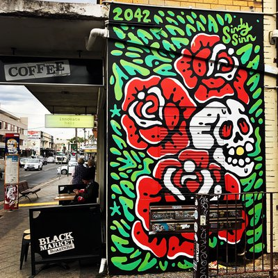 """Vibrant street art outside Black Market Roasters. One of our favourite coffee places."""